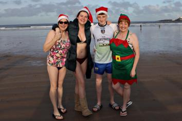 Festive dip for Coleraine Hospice Group during the annual Christmas Day Splash at Portstewart Strand
