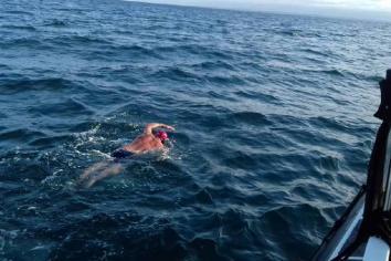 Gavin completes charity swim